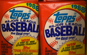 Two packs of 1988 Topps Major League Baseball cards with an illustrated baseball against a red background.